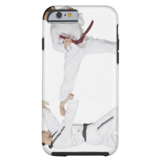 Mid adult man practicing kickboxing with a young tough iPhone 6 case