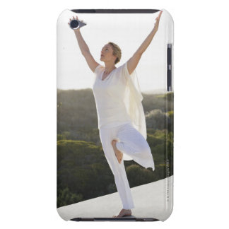 Mid adult woman practicing yoga 2 barely there iPod cover