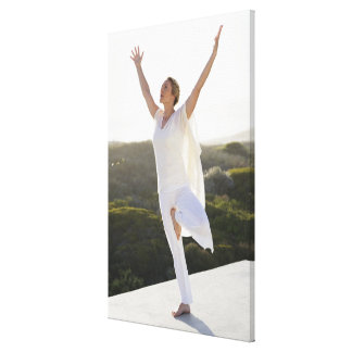 Mid adult woman practicing yoga 2 canvas print