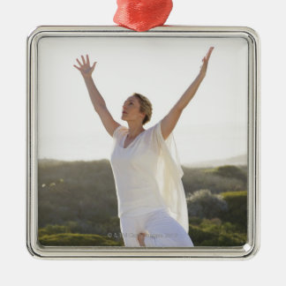 Mid adult woman practicing yoga 2 christmas ornament
