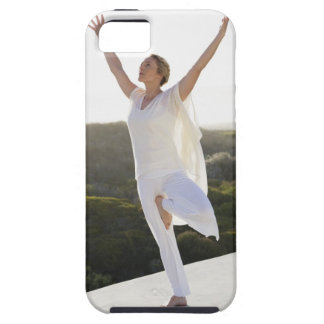 Mid adult woman practicing yoga 2 iPhone 5 covers
