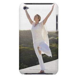Mid adult woman practicing yoga 2 iPod Case-Mate case
