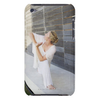 Mid adult woman practicing yoga Case-Mate iPod touch case