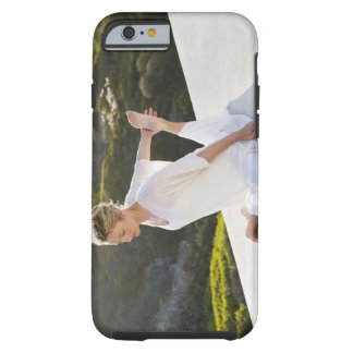 Mid adult woman practicing yoga exercise at tough iPhone 6 case