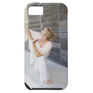 Mid adult woman practicing yoga iPhone 5 cover