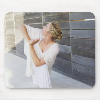 Mid adult woman practicing yoga mouse mat