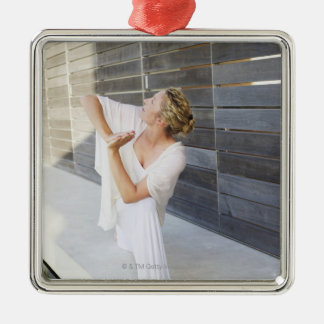 Mid adult woman practicing yoga Silver-Colored square decoration