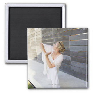 Mid adult woman practicing yoga square magnet