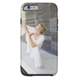 Mid adult woman practicing yoga tough iPhone 6 case