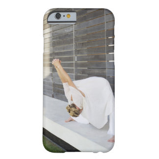 Mid adult woman stretching her arms barely there iPhone 6 case