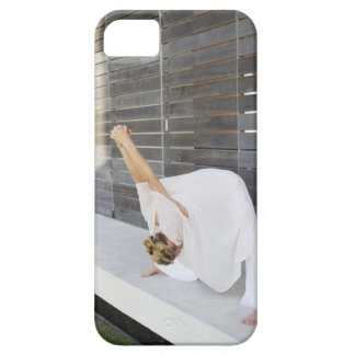Mid adult woman stretching her arms case for the iPhone 5