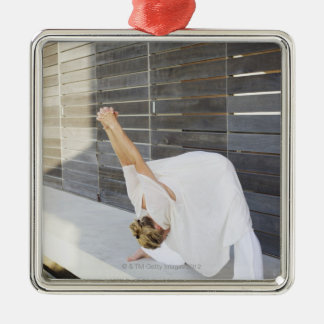 Mid adult woman stretching her arms christmas ornament