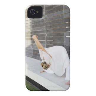 Mid adult woman stretching her arms iPhone 4 case