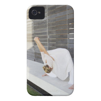 Mid adult woman stretching her arms iPhone 4 covers