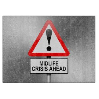 Midlife crisis warning. cutting board