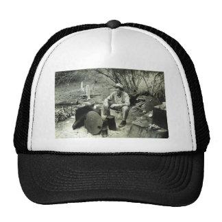 Migrant at campfire - 1939. trucker hat