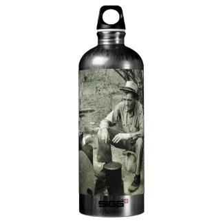 Migrant at campfire - 1939. SIGG traveller 1.0L water bottle