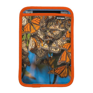 Migrating monarch butterflies cling to leaves iPad mini sleeve
