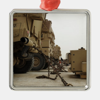 Military vehicles are locked down on semi truck christmas ornament
