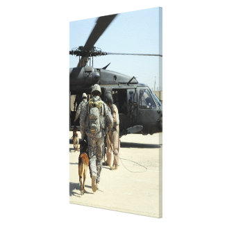 Military working dog handlers board a helicopte canvas print