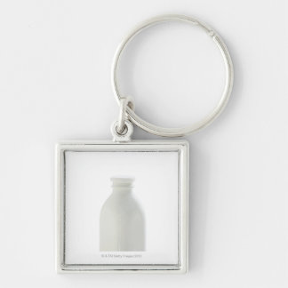 Milk bottle on white background Silver-Colored square key ring