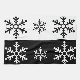Minimalist black and white snowflake pattern tea towel