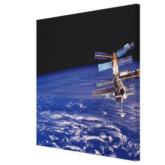 Mir Space Station floating above the Earth Canvas Print