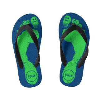Mischievous Green Smiley-Toes™ on Antic Blue Flip Flops