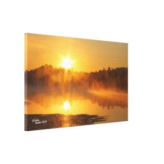 Misty lake sunrise Stretched Canvas Print
