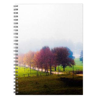 Misty meadow in autumn spiral notebooks