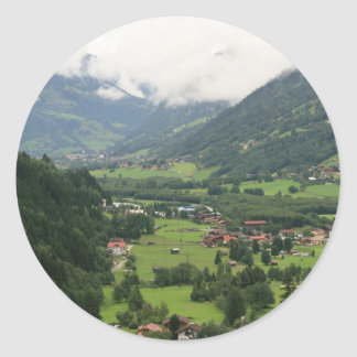 Misty morning in the Alps Round Sticker