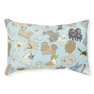 Mix of small dogs on a light blue background pet bed