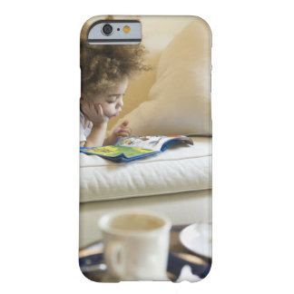 Mixed race boy reading book on sofa barely there iPhone 6 case