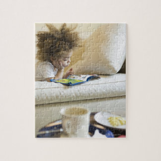 Mixed race boy reading book on sofa jigsaw puzzle