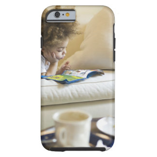 Mixed race boy reading book on sofa tough iPhone 6 case