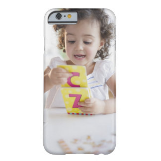 Mixed race girl playing with alphabet cards barely there iPhone 6 case