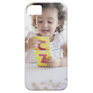 Mixed race girl playing with alphabet cards iPhone 5 case