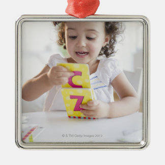 Mixed race girl playing with alphabet cards Silver-Colored square decoration