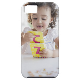 Mixed race girl playing with alphabet cards tough iPhone 5 case
