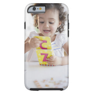 Mixed race girl playing with alphabet cards tough iPhone 6 case