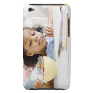 Mixed race girl reading and eating breakfast barely there iPod covers