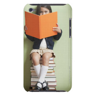 Mixed race girl sitting on stack of books barely there iPod case