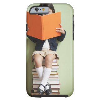 Mixed race girl sitting on stack of books tough iPhone 6 case