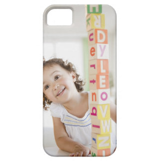 Mixed race girl stacking blocks iPhone 5 case