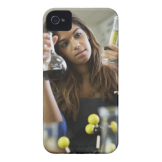 Mixed Race teenaged girl in science class iPhone 4 Cover