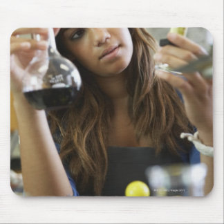 Mixed Race teenaged girl in science class Mousepads