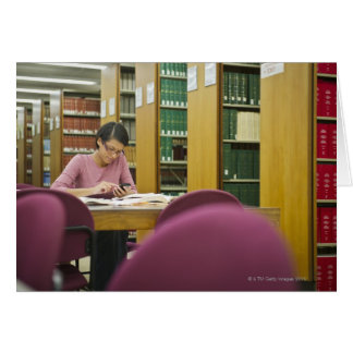 Mixed race woman doing research in library 2 greeting card