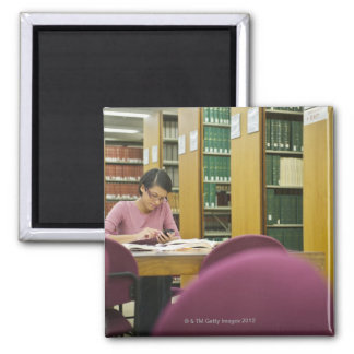 Mixed race woman doing research in library 2 square magnet