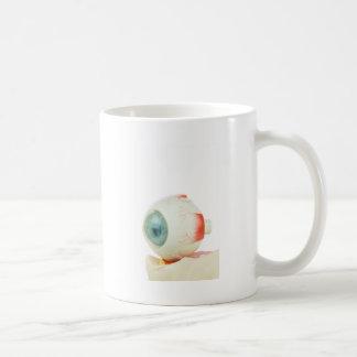 Model human eye isolated on white background.jpg basic white mug