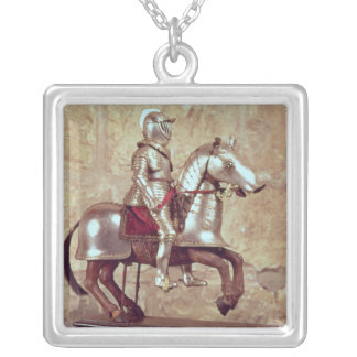 Model of a barded horse and rider, c.1640 silver plated necklace